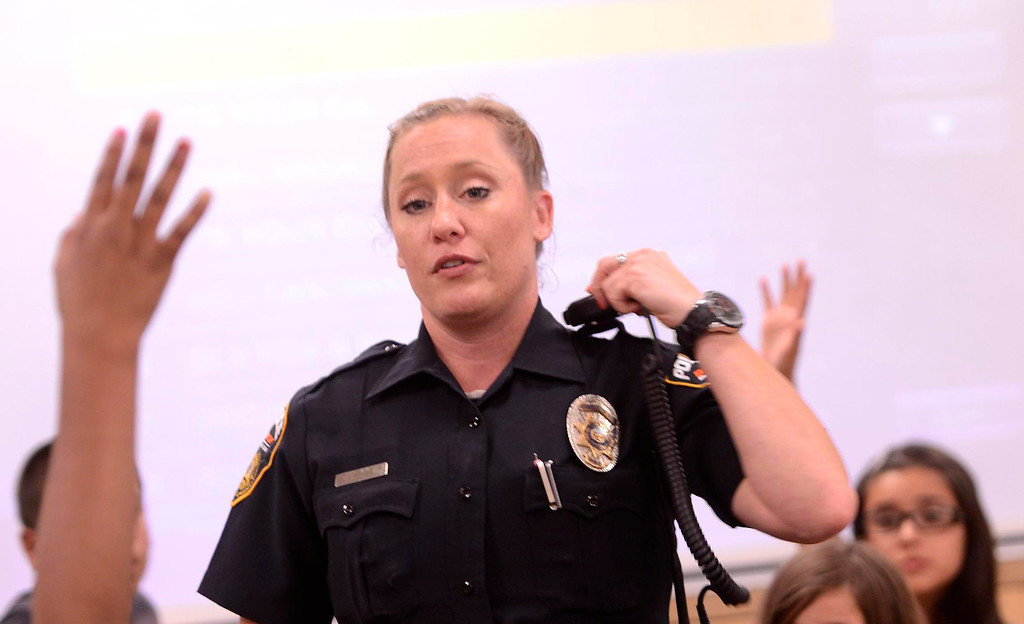 Description of . BNSF Railway Police Senior Special Agent Aimee Schmidt talks to third graders about her job during the final day of the 19th Annual Career Awareness Week at Lankershim Elementary School in Highland June 6, 2013.  GABRIEL LUIS ACOSTA/STAFF PHOTOGRAPHER.
