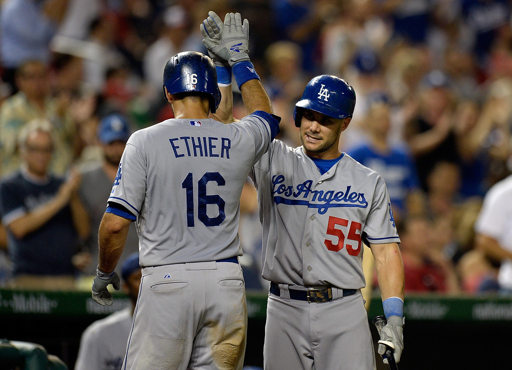 Description of . Andre Ethier #16 of the Los Angeles Dodgers celebrates with Skip Schumaker #55 after hitting a solo home run in the top of the ninth inning during a game against the Washington Nationals at Nationals Park on July 19, 2013 in Washington, DC. The Los Angeles Dodgers defeated the Washington Nationals 3-2.  (Photo by Patrick McDermott/Getty Images)