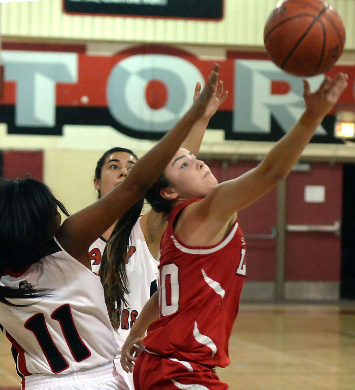 Description of . Workman's Alicia Aguirre (00) drives to the basket past Gladstone's Tiara Rice (11) in the first half of a prep basketball game at Gladstone High School in Covina, Calif., on Friday, Jan. 17, 2014. (Keith Birmingham Pasadena Star-News)