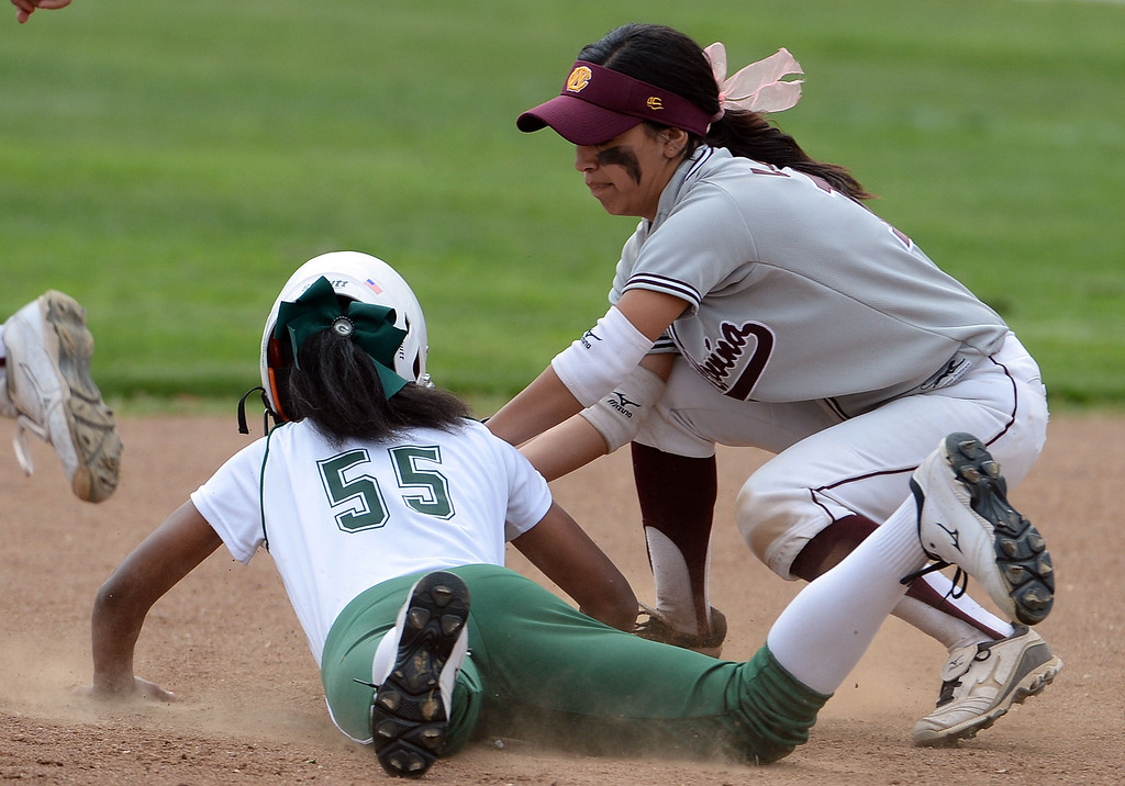 Description of . West Covina's Nadiya Lozano (C) tags out Bonita's Miiah Sutton (55) in a run down between second and third base in the first inning of a prep softball game at Los Flores Park in La Verne, Calif., on Thursday, March 27, 2014. Bonita won 6-3. (Keith Birmingham Pasadena Star-News)