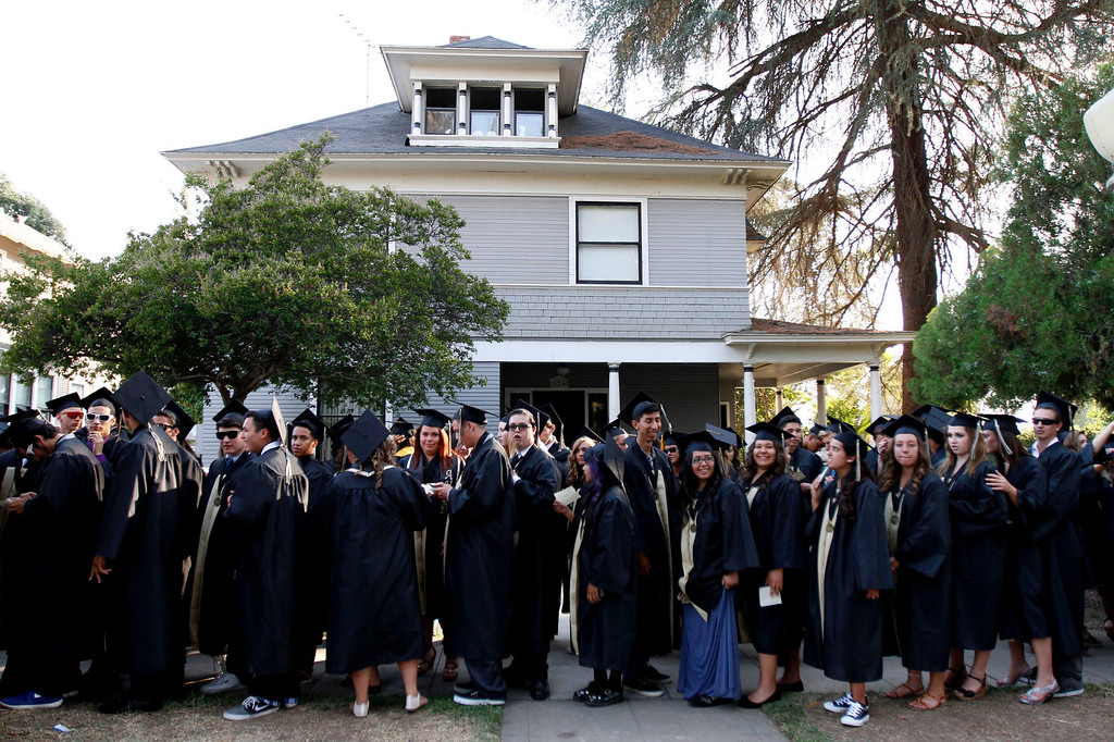 Description of . Citrus Valley High School graduates wait in line prior to the start of the ceremony on Wednesday, June 11, 2014 at the Redlands Bowl in Redlands, Ca.  (Photo by Micah Escamilla/Redlands Daily Facts)