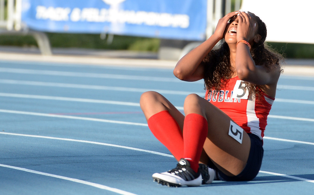Description of . Dublin's Mecca McGlaston reacts after winning the 100 meter hurdles  during the CIF California State Track & Field Championships at Veteran's Memorial Stadium on the campus of Buchanan High School in Clovis, Calif., on Saturday, June 7, 2014. 
