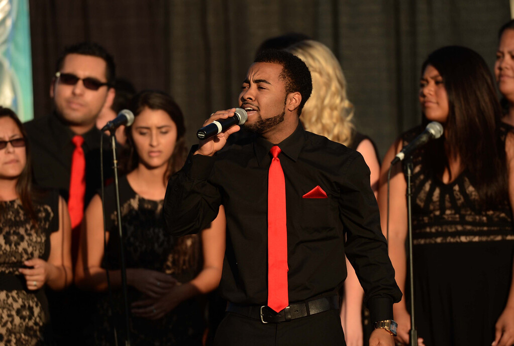 Description of . Joseph Yates Jr. sings with the Azusa Pacific University Gospel Choir at the Pomona Day Of Prayer Sunday November 10, 2013 at Ganesha High School Nancy McCracken stadium in Pomona.LaFonzo Carter/ Staff Photographer