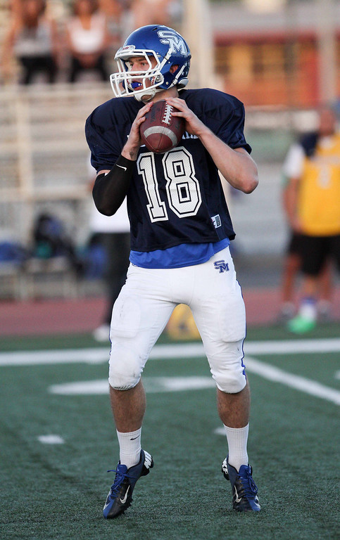 Description of . San Marino's Andrew Ferraco (18) looks to pass during the 35th Annual Hall of Fame All-Star Football Game at West Covina High School in West Covina, CA on Friday, May 16, 2014. (Correspondent Photo by David Thomas for the Pasadena Star News)