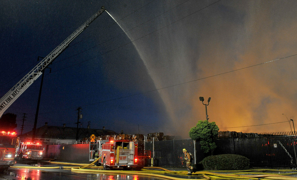 Description of . Firefighters battle a massive fire at the Pan Pacific Fiber, Inc. recycling plant 9n the 14000-block of Marquardt Ave. in Santa Fe Springs. (Staff Photo by Keith Durflinger/Whittier Daily News)