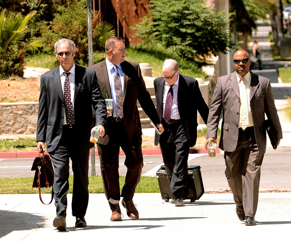 Description of . Lawyers arrive to the United States Bankruptcy Court in Riverside August 28, 2013.  GABRIEL LUIS ACOSTA/STAFF PHOTOGRAPHER.