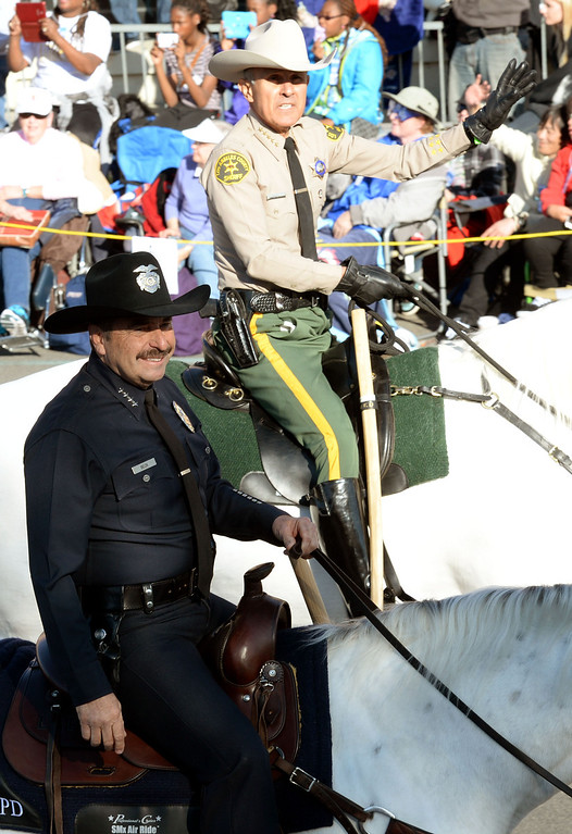 Description of . LPAD Chief Charlie Beck and LA County Sheriff Lee Baca ride on horses during the 2014 Rose Parade in Pasadena, CA January 1, 2014.(Keith Durflinger/San Gabriel Valley Tribune)
