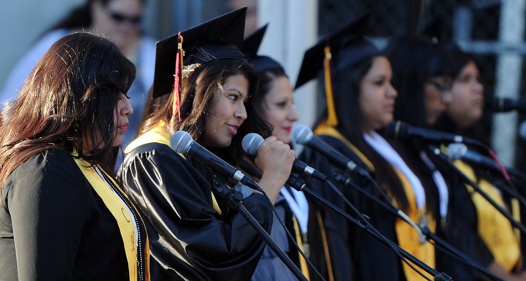 Description of . The choir performs during the Vail High School commencement at Vail High School on Tuesday, June 18, 2013 in Montebello, Calif.