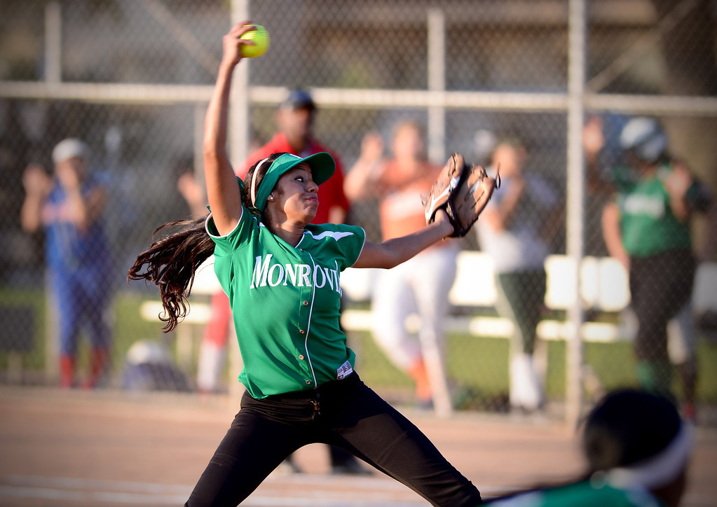 Description of . Monrovia's Adrienne Guerra (00) pitches during the West SGV softball all-star game Wednesday night, June 11, 2014 at Live Oak Park in Temple City. (Photo by Sarah Reingewirtz/Pasadena Star-News)