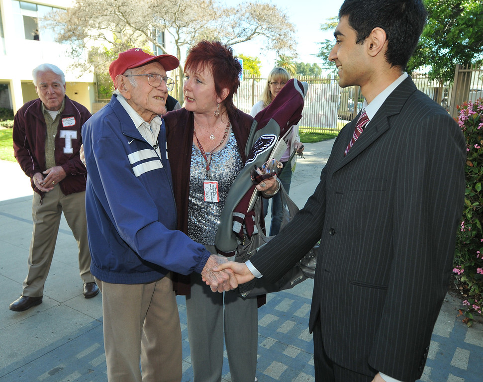 Description of . Torrance---3/31/11---Daily Breeze Photo:  Robert Casillas ---  Torrance legend Louis Zamperini paid a visit to his alma mater Torrance High to visit with alumni and meet students.Zamperini is introduced to Torrance ASB president Danish Akmal by Alumni pres. Gail Morgan.