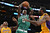 Celtics' Kevin Garnett comes up with the rebound as Lakers Metta World Peace and Earl Clark defend during first half action at Staples Wednesday.  Photo by David Crane/Staff Photographer