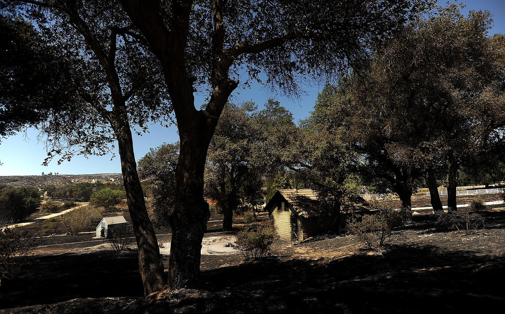 Description of . A structure damaged by the Silver Fire stands along Twin Pines Road in the mountains south of Banning August 8, 2013.   GABRIEL LUIS ACOSTA/STAFF PHOTOGRAPHER.