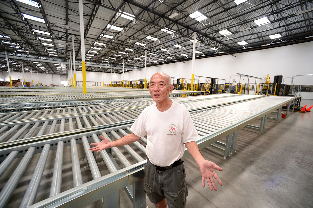 Description of . David Tran, owner of Huy Fong Foods, shows his new $50 million 650,000 square foot factory in Irwindale where he plans to move his company, the maker of the famous Sriracha chili sauce. Tran says he expects the company to outgrow the new facility by 2017. (SGVN/Staff Photo by Sarah Reingewirtz)