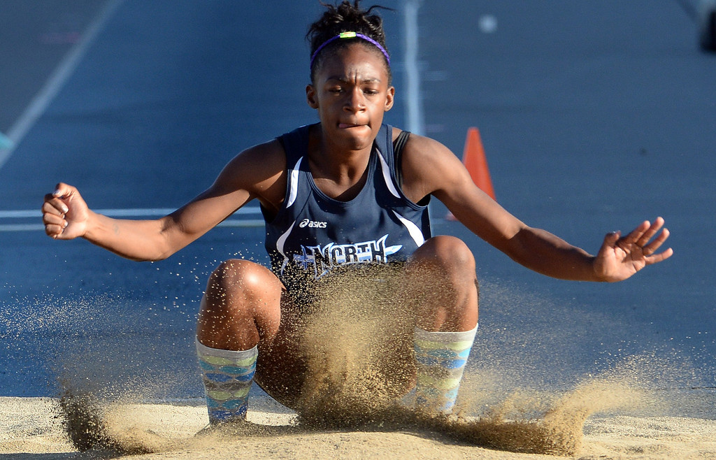Description of . North Torrance Jasmine Bass competes in the Triple Jump during the CIF-SS Masters Track and Field meet at Falcon Field on the campus of Cerritos College in Norwalk, Calif., on Friday, May 30, 2014.   (Keith Birmingham/Pasadena Star-News)