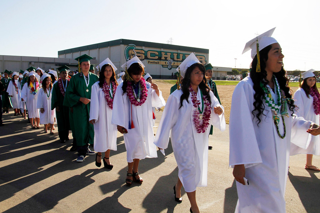 Description of . Graduates during Schurr High School 2013 Commencement Exercises, at Ken Davis Field, at Schurr High School in Montebello, Thursday, June 20, 2013. (Correspondent Photo by James Carbone/SWCITY)