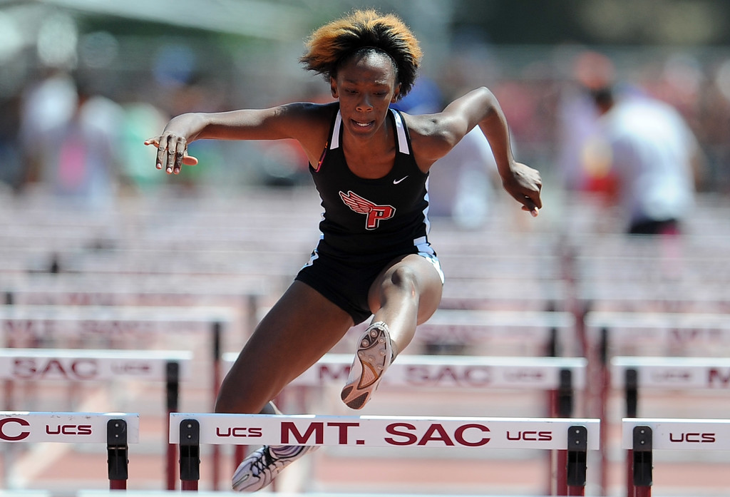 Description of . Pasadena's Rachael Richardson in the 100 meter high hurdles during the CIF-SS track & Field championship finals in Hilmer Stadium on the campus of Mt. San Antonio College on Saturday, May 18, 2013 in Walnut, Calif.  (Keith Birmingham Pasadena Star-News)