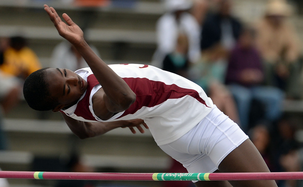 Description of . Alemany's Earnest Sears competes in the Division 3 High jump during the CIF Southern Section track and final Championships at Cerritos College in Norwalk, Calif., on Saturday, May 24, 2014. 
