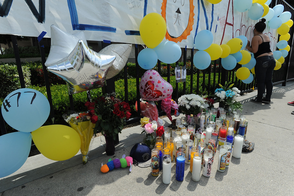 Description of . Students at El Monte High School brought flowers, candles and other items in remembering Adrian Castro, a Senior student who was killed in bus crash in Northern California that took the lives of 10 people. El Monte, CA. 4/13/2014(Photo by John McCoy / Los Angeles Daily News)