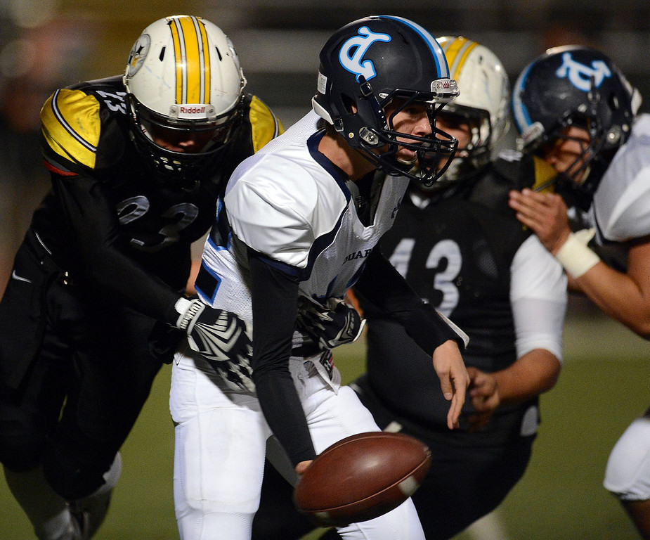 Description of . Duarte quarterback Isaiah Scott (12) passes against Bassett in the first half of a prep football game at Bassett High School in La Puente, Calif., on Friday, Nov. 1, 2013.    (Keith Birmingham Pasadena Star-News)