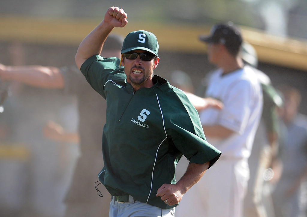 Description of . South (Torrance) head coach Grady Sain reacts after tying Northview 4-4 in the seventh inning of a CIF-SS prep second round playoff baseball game at Northview High School on Tuesday, May 21, 2013 in Covina, Calif. Northview won 5-4. 