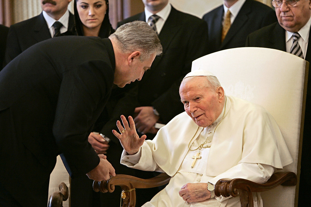 Description of . Pope John Paul II greets Croatian Prime Minister Ivo Sanader, left, during a private audience at the Vatican, Tuesday, Feb. 22, 2005. Prime Minister Sanader was the first foreign leader to meet with the pontiff since he was  rushed to the hospital with breathing problems three weeks ago. (AP Photo/Pool, Tony Gentile)
