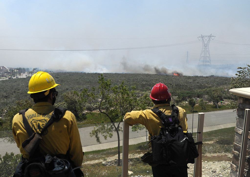 Description of . U.S. Forest Service Firefighters check hot spot from the Etiwanda Fire at home in the Rancho Etiwanda Estates in Rancho Cucamonga, Ca.,Wednesday, April 30, 2014. (Photo by John Valenzuela/Inland Valley Daily Bulletin)