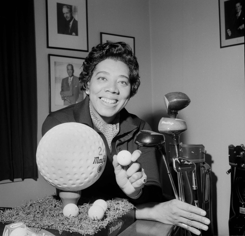 Description of . Althea Gibson, is shown in New York City,  Dec. 12, 1963, after she signed a contract as a golf pro with Dunlop. (AP Photo/Harry Harris)