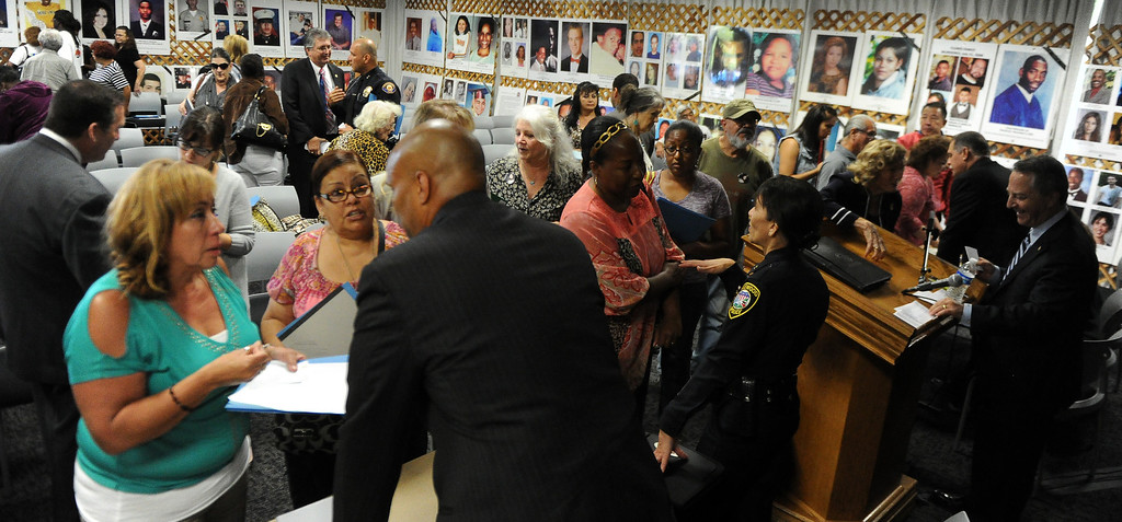 Description of . Victims families speaks to officials during a Los Angeles County Sheriff's Department and Justice for Murdered Children unsolved homicide summit at the Los Angeles County Sheriff's headquarters on Saturday, July 20, 2013 in Monterey Park, Calif.  (Keith Birmingham/Pasadena Star-News)