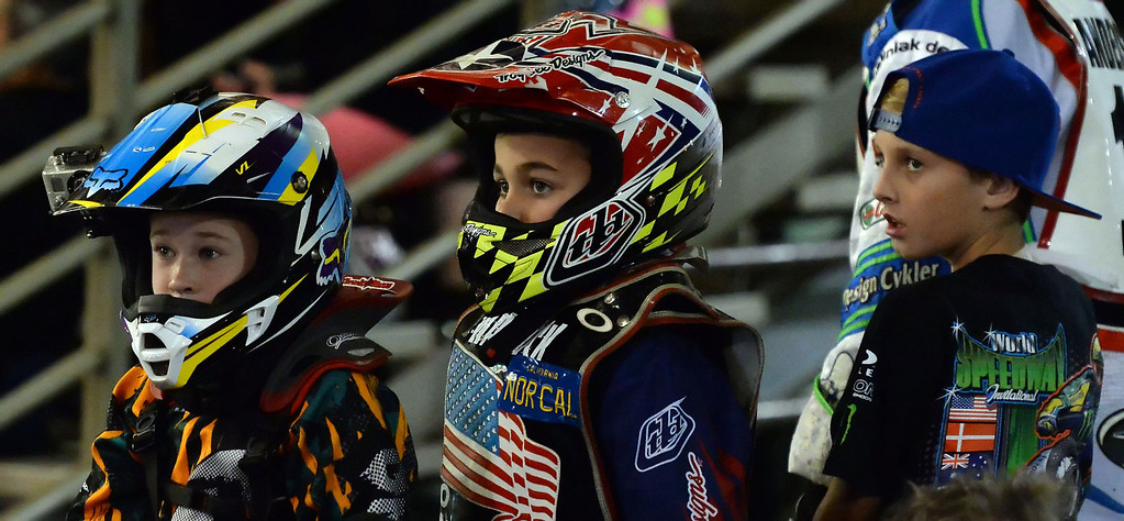 Description of . Young riders look on during the second race during the Monster Energy Speedway Cycles at the Industry Speedway in the Industry Hills Grand Arena in Industry, Calif., on Saturday, Dec. 28, 2013.     (Keith Birmingham Pasadena Star-News)