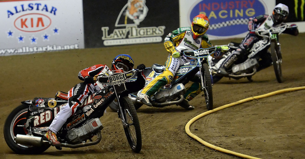 Description of . Charlie Venegas (11), Darcy Ward (10) and Billy Hamill (9) in the third race during the Monster Energy Speedway Cycles at the Industry Speedway in the Industry Hills Grand Arena in Industry, Calif., on Saturday, Dec. 28, 2013.     (Keith Birmingham Pasadena Star-News)