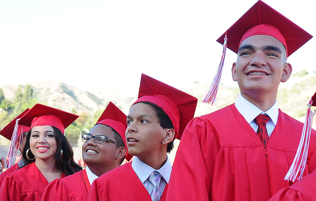 Description of . Students make their way to their seats during the Whittier High School graduation at Whittier College in Whittier, Calif., on Wednesday, June 4, 2014.  (Keith Birmingham/Pasadena Star-News)