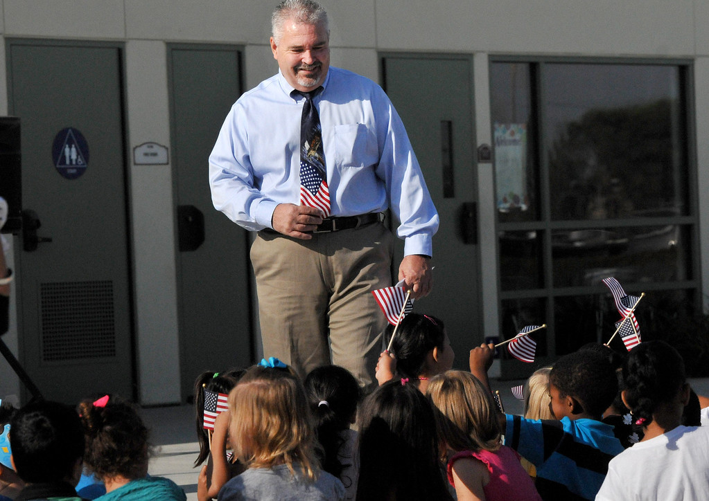 Description of . Tim Hoch principal at Mission Elementary in Redlands  before the start of the the schools Patriot's Day celebration, marking the 12th Anniversary of the 9/11 attacks, Wednesday, September 11, 2013. Military veteran Robert Kafader discussed the tragic events that happen on Sept. 11, 2001, when nearly 3000 people were killed during the terrorist attacks 12 years ago.