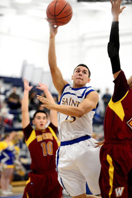 Description of . San Dimas' Tony Hugo (13) goes for a shot as Wilson defeats San Dimas 45-43 Friday night, January 10, 2014 at San Dimas High School.  (Photo by Sarah Reingewirtz/Pasadena Star-News)