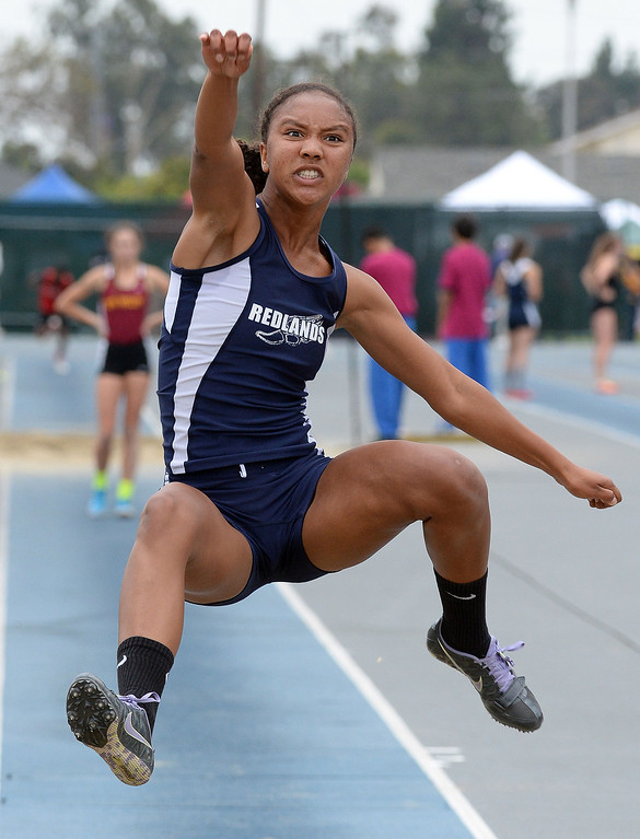 Description of . Redland's Margaux Jones competes in the Division 2 long jump during the CIF Southern Section track and final Championships at Cerritos College in Norwalk, Calif., on Saturday, May 24, 2014. 