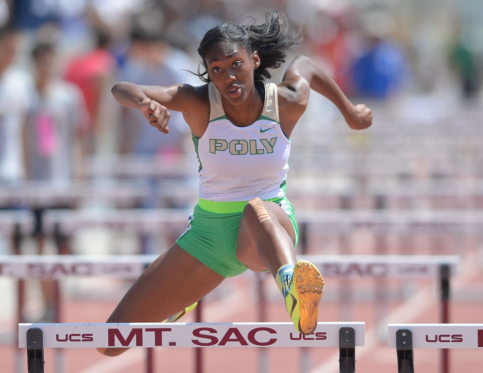 Description of . Long Beach Poly's Ebony Crear takes second in the 100 meter Division 1 high hurdles race of the CIF Southern Section Track and Field Championships Saturday at Mt. SAC. 20130518 Photo by Steve McCrank / Staff Photographer