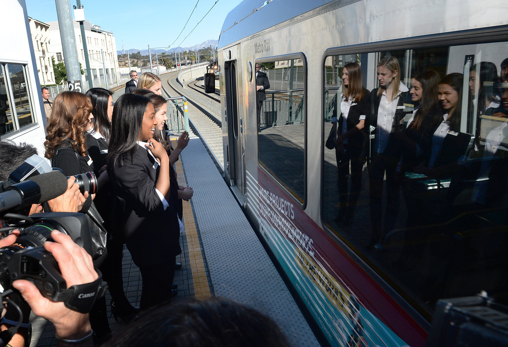 Description of . The 2014 Tournament of Roses Queen and Princesses wait to board a Gold Line train from historic Union Station on Friday December 27, 2013. The event is to commemorate the 10th official year of Metro Rail service to the Tournament of Roses parade events at Union Station. (Staff Photo by Keith Durflinger/Pasadena Star-News)