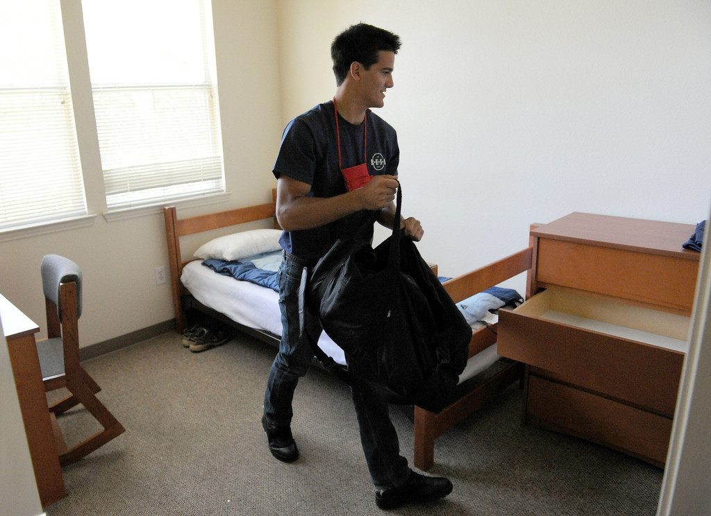 Description of . (John Valenzuela/ Staff Photographer) Redlands Emergency Services Academy (R.E.S.A) student Craig Roach 19, of Yucaipa gets settled in his dorm at the University Redlands, July 18, 2013. The annual academy, which has close to two dozens participating this year, takes high school grads on a week long course to see if they have what it takes to have a career in public safety. RESA is taught by area firefighters and police officers.