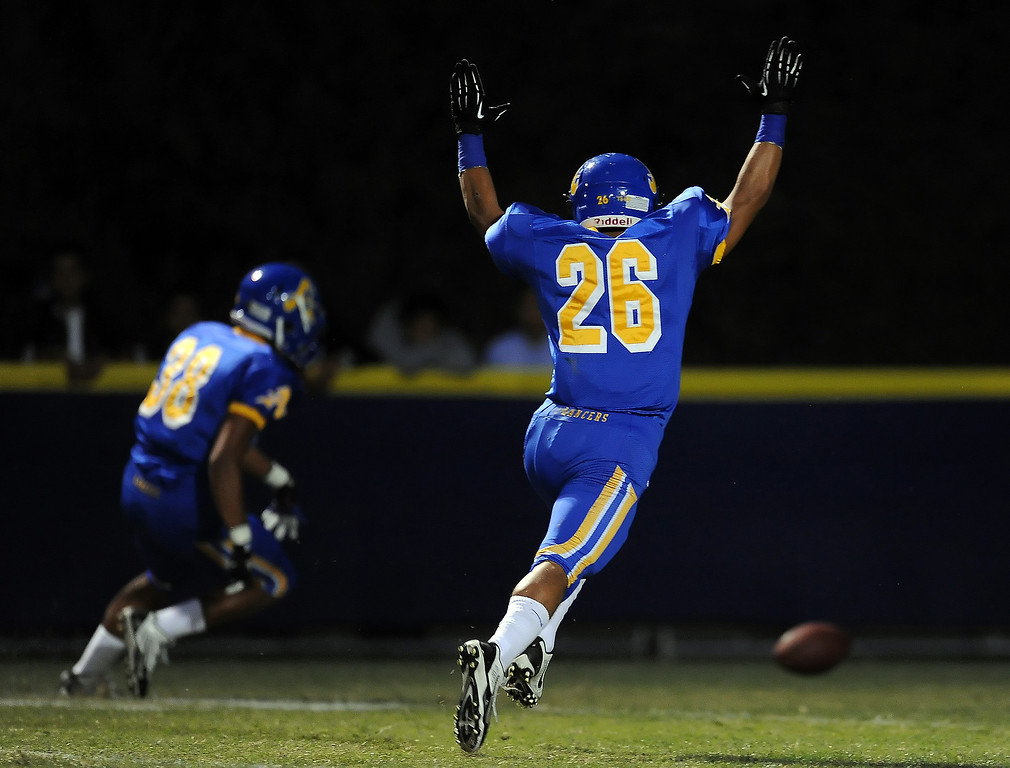 Description of . Bishop Amat's Aaron Austin (38) dives on a football in the end zone for a touchdown after blocking a Charter Oak punt as Gabriel Perez (26) reacts in the first half of a prep football game at Bishop Amat High School in La Puente, Calif. on Friday, Sept. 20, 2013.    (Photo by Keith Birmingham/Pasadena Star-News)