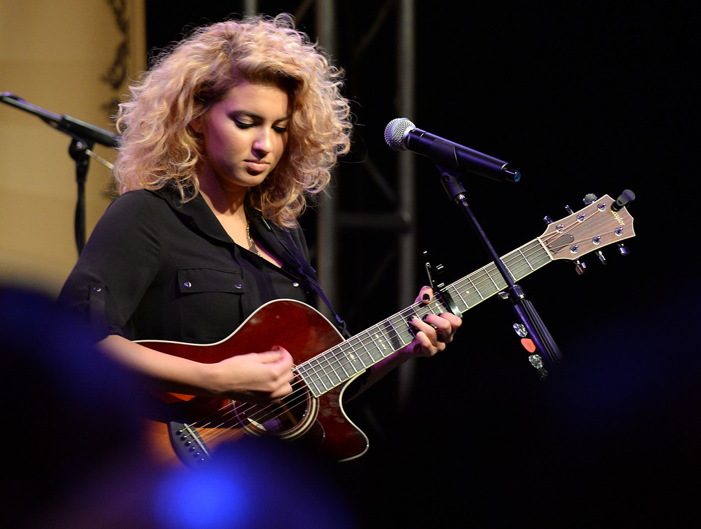 Description of . New pop singer Tori Kelly performs in the Taylor Guitars booth during The NAMM (National Association of Music Merchants) Show, the world wide music trade show, at the Anaheim Convention Center in Anaheim on Friday January 24, 2014. NAMM is a music trade show drawing retailers and other industry people to Anaheim for four days of everything music. (Staff Photo by Keith Durflinger/San Gabriel Valley Tribune)