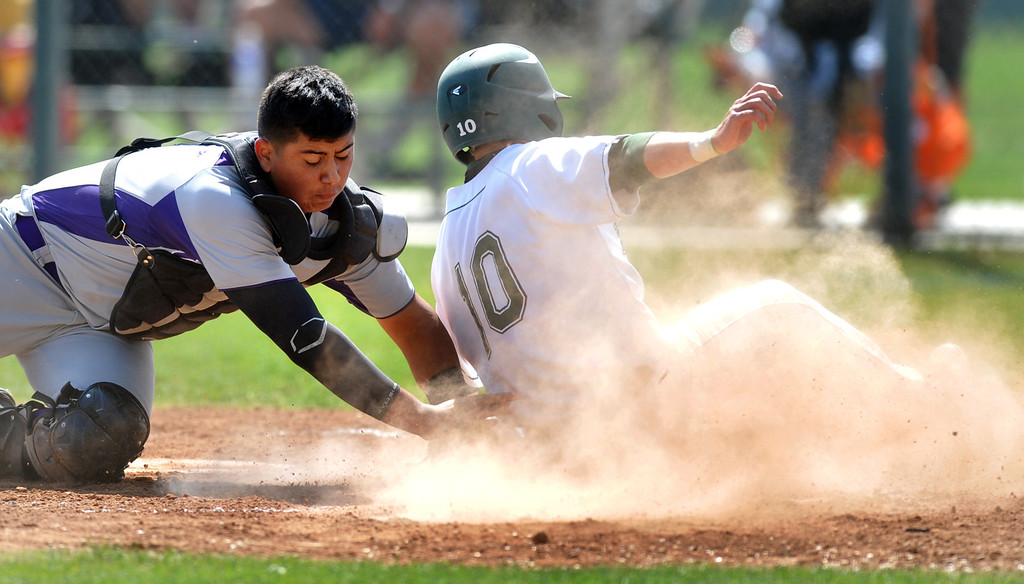 Description of . Bonita's Junstin row (#10) slides at home plate and is tagged out by Cathedral catcher David Sanchez in their CIF playoff game at Bonita High School in La Verne on Thursday May 16, 2013. Cathedral beat Bonita 3-1. (SGVN/Staff Photo by Keith Durflinger)