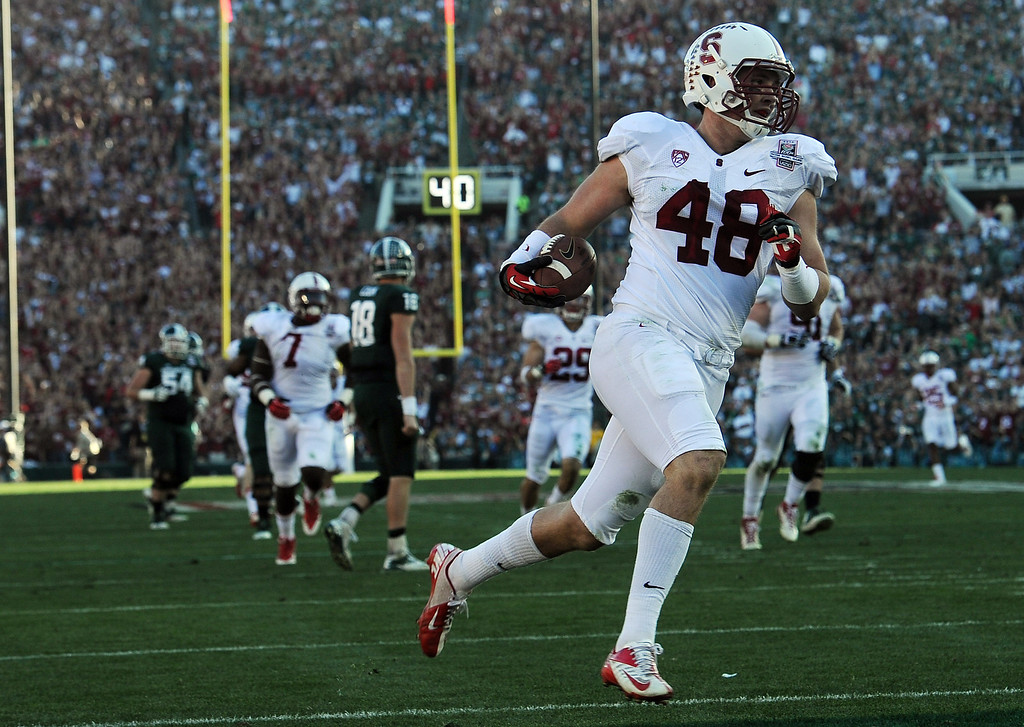 Description of . Stanford's Kevin Anderson #48 runs in to the end zone after intercepting a pass in the 2nd quarter against Michigan State during the 100th Rose Bowl game in Pasadena Wednesday, January 1, 2014. (Photo by Hans Gutknecht/Los Angeles Daily News)