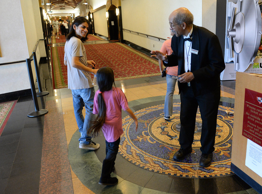 Description of . Al Harris has become a local icon collecting tickets and giving high fives to moviegoers since being hired by Krikorian in 1992.  (John Valenzuela/Photographer)