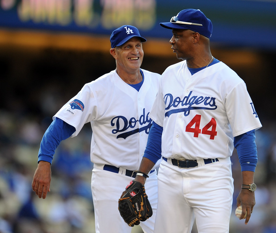 Description of . Former Los Angeles Dodgers Bob Welch, left, with Darryl Strawberry (44) during the Old-Timers game prior to a baseball game between the Atlanta Braves and the Los Angeles Dodgers on Saturday, June 8, 2013 in Los Angeles.   (Keith Birmingham/Pasadena Star-News)