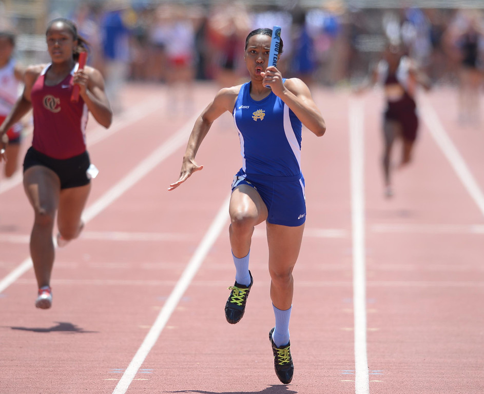 Description of . St. Mary's Academy's Rachel Toliver anchors her team to a win in the 4x100 meter Division 4 relay race of the CIF Southern Section Track and Field Championships Saturday at Mt. SAC. 20130518 Photo by Steve McCrank / Staff Photographer