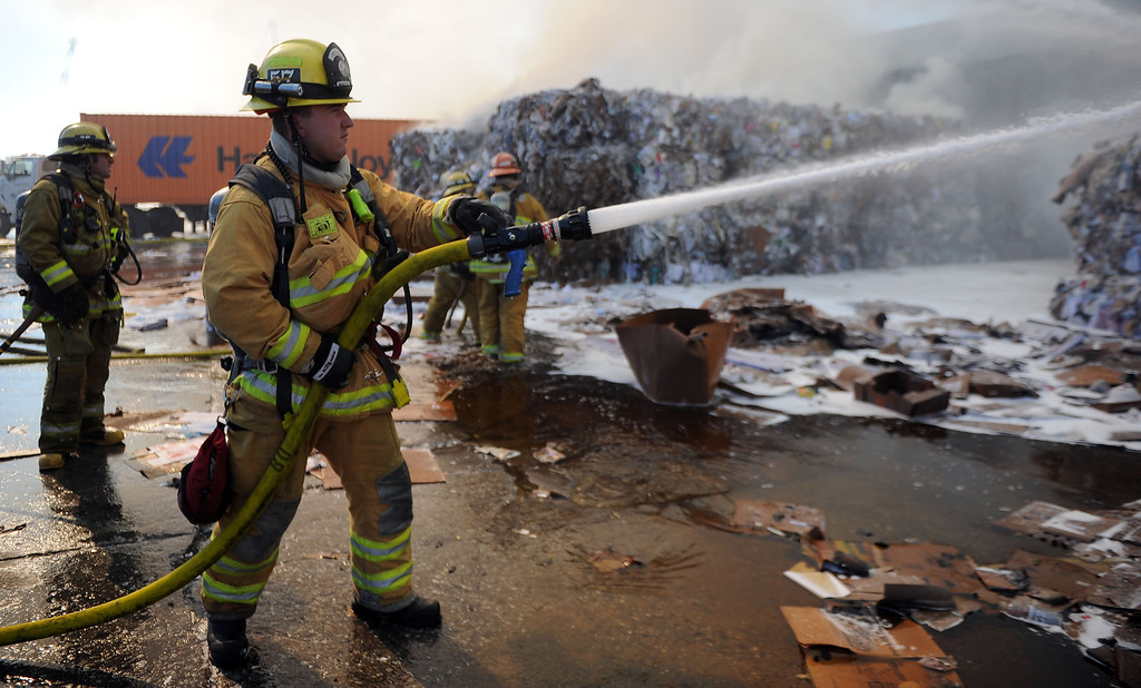 Description of . Firefighters from Montebello and surrounding agencies from the cities of Downey, Alhambra, Monterey Park fire dept. fight a three alarm fire at Belmont Fibers Inc. along Chapin Road in Montebello, Calif., on Friday, Jan. 17, 2014. (Keith Birmingham Pasadena Star-News)