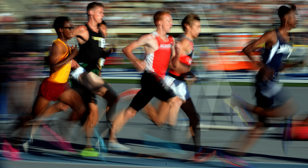 Description of . Athletes competes in the 1600 meter run during the CIF-SS Masters Track and Field meet at Falcon Field on the campus of Cerritos College in Norwalk, Calif., on Friday, May 30, 2014.   (Keith Birmingham/Pasadena Star-News)