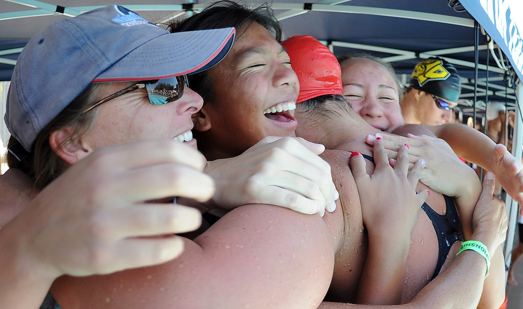 Description of . Glendora's Nicole Gautreau is mobbed by teammates after winning the 500 freestyle during the CIF-SS Division II swim finals at Riverside City College on Saturday, May 11, 2013 in Riverside, Calif.  (Keith Birmingham Pasadena Star-News)