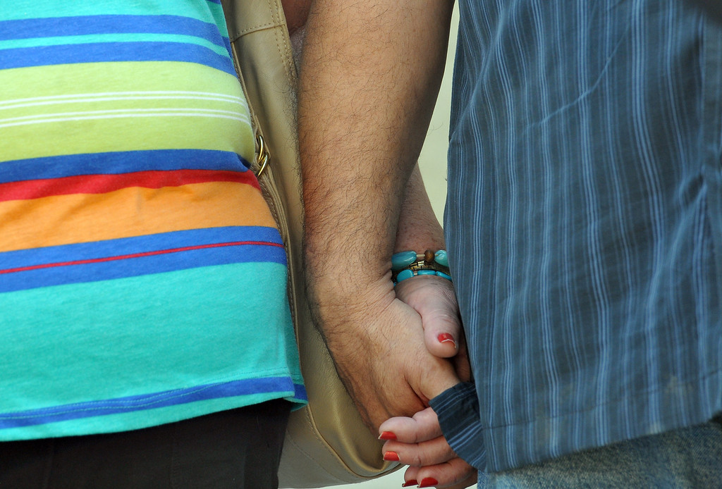 Description of . (John Valenzuela/Staff Photographer) Parents of Sylvia Flores, Robert  and Sylvia Flores hold hands, during a press conference outside the police annex in Redlands, CA.Tuesday, September 12, 2013. Flores, a 23-year-old woman from Perris, CA. who's body was found in a orange groves near Citrus Plaza shopping center in Redlands.