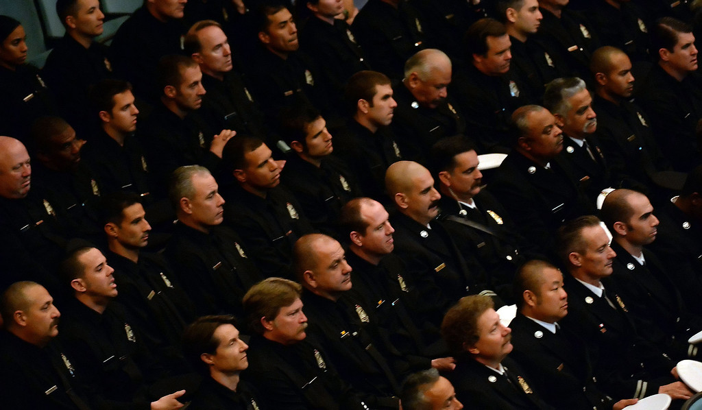 Description of . Members of the Pasadena fire dept. listen to speakers during a celebration of life service for former Pasadena Fire dept. Capt. and California State fire marshall, John Tennant at the Pasadena Civic Auditorium in Pasadena, Calif., on Wednesday, Feb. 5, 2014. (Keith Birmingham Pasadena Star-News)