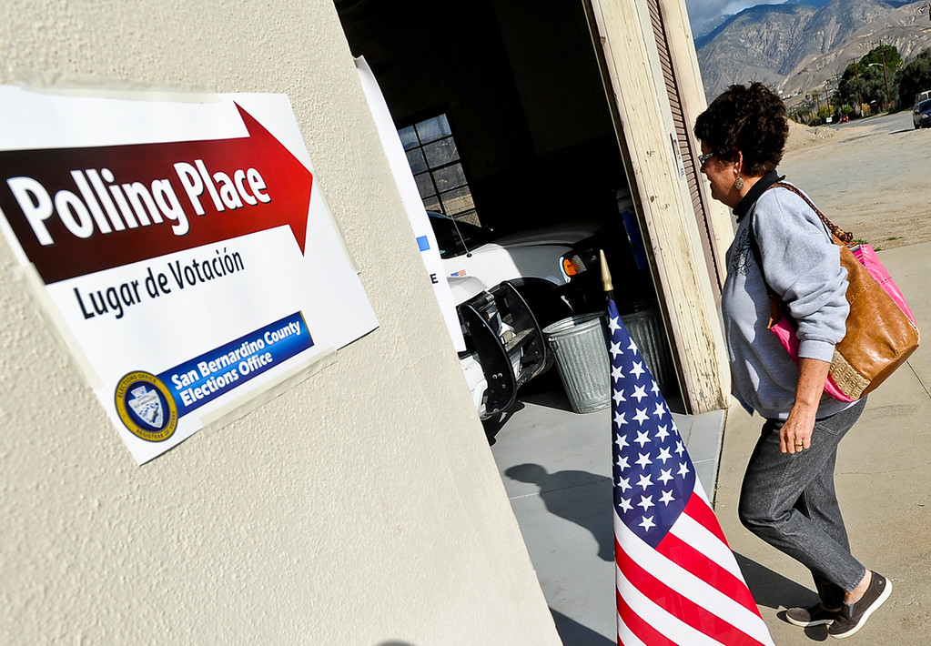 Description of . San Bernardino resident Claudia Stoll goes to place her vote in the city's general and special municipal election at the San Bernardino Mountain Search and Rescue polling location on Tuesday, Feb. 4, 2014. (Photo by Rachel Luna / San Bernardino Sun)